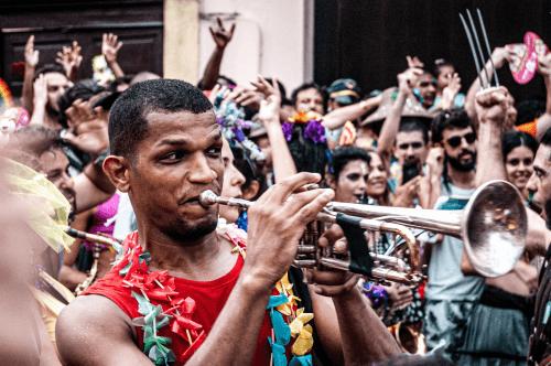 Man blowing in trumpet