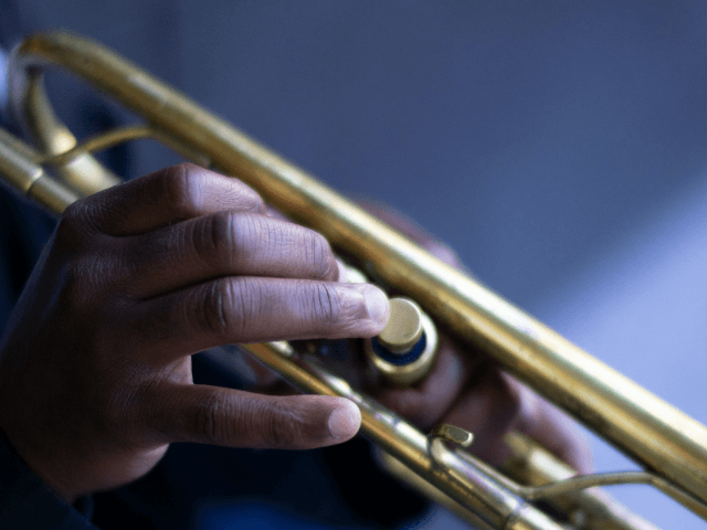 Fingers on trumpet valve
