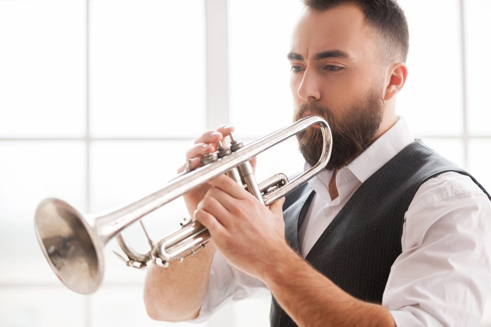 Bearded man playing the trumpet